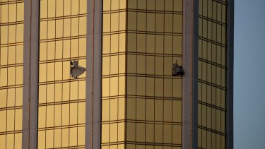 Curtains billow out of broken windows at the Las Vegas Mandalay Bay resort and casino from where Stephen Paddock shot festival goers.