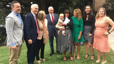 The Turnbull and Pence families at Kirribilli House.