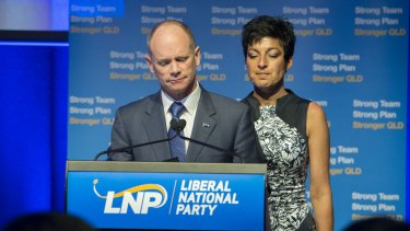 Former Premier Campbell Newman with his wife Lisa in front of supporters on the night of his election defeat.
