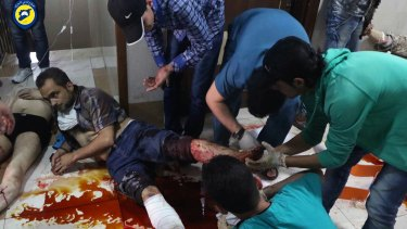 Victims of air strikes receive treatment on the floor of a clinic in Aleppo on Sunday.