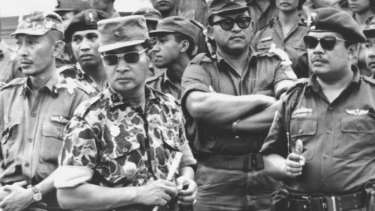 Suharto (in patterned uniform) at the funeral of the slain generals in 1965, an event that precipitated a massive purge against communits, real and perceived.