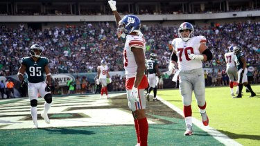 New York Giants' Odell Beckham raises his fist after a touchdown during an NFL  game against the Philadelphia Eagles on Sunday.