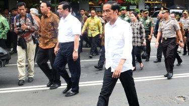 Indonesian President Joko Widodo, centre, visits the site of last week's terror attacks in Central Jakarta.