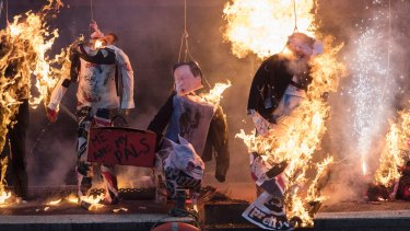 Effigies of British political figures were set ablaze as part of Saturday's protest.
