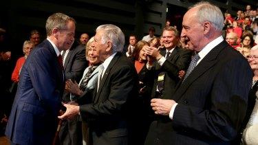 Opposition Leader Bill Shorten greets former prime minister Bob Hawke and former prime minister Paul Keating during the launch.