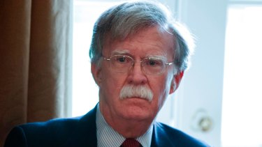 National Security Adviser John Bolton listens as US President Donald Trump speaks during a cabinet meeting at the White House in April.