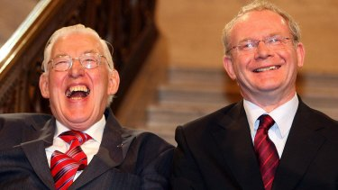 Northern Ireland's first minister Ian Paisley and deputy first minister Martin McGuinness smile after being sworn in  at Stormont in May 2007.