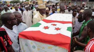 Slain Burundian opposition figure Zedi Feruzi is buried in the national flag in May.