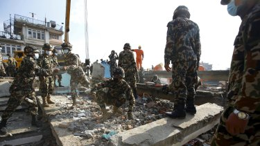 Soldiers from the Nepalese army clear debris from a collapsed house while searching for victims in Kathmandu.