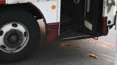 Blood is seen at a crime scene after a bus driver was killed by suspected gang members on Monday.