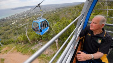 Amazing vista: Colin Matthews, of  Rosebud, who at age 13, in 1960, was the first person to ride the Arthurs Seat chairlift, rides the new Arthurs Seat Eagle cable car.