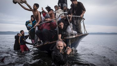 A small boat filled with migrants comes ashore in Greece after crossing from Turkey. Many migrants then head to France, Germany or Sweden for asylum.