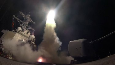 The guided missile destroyer USS Porter launches a Tomahawk missile as the US blasted a Syrian air base with a barrage of cruise missiles.