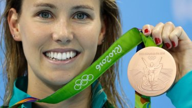 Australia's Emma McKeon shows off her bronze medal after the women's 200m freestyle final in Rio.