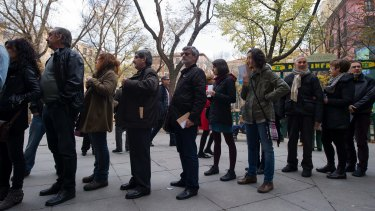 Queuing to vote in Madrid on Sunday.