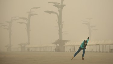 A woman wearing a mask practises roller blading at Olympic Park, Beijing, earlier in the month.