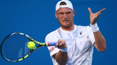 Sam Groth of Australia plays a forehand in his first round match.