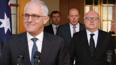 Prime Minister Malcolm Turnbull, Immigration Minister Peter Dutton and Attorney-General George Brandis.