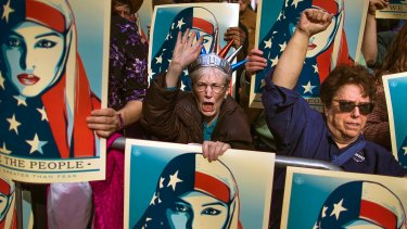 Widespread protests greeted the first travel ban, which was later halted by the courts.