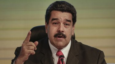 """Venezuela's President Nicolas Maduro blames his country's woes on an """"economic war"""" waged by his opponents."""