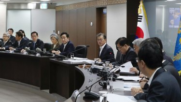 South Korean President Moon Jae-in, centre, presides over a meeting of the National Security Council to discuss the latest missile launch on Wednesday.