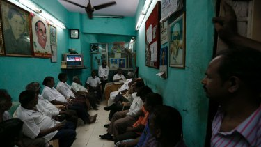 Supporters of India's Tamil Nadu state Chief Minister Jayaram Jayalalithaa watch TV news about their leader's health condition on Monday.