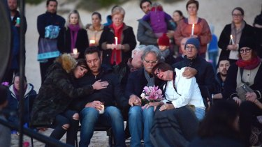 Justine's parents Maryan Heffernan, and John Ruszczyk, right, with their son Jason Ruszczyk and his wife Katarina Ruszczyk, left at Freshwater Beach during a vigil for their daughter.