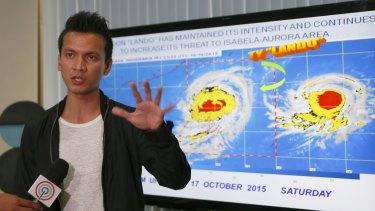 "Forecaster Aldczar Aurelio speaks at a media briefing in Quezon City on Typhoon Koppu (known in the Philippines as ""Lando"")."