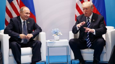 US President Donald Trump speaks during a meeting with Russian President Vladimir Putin at the G20 Summit in Hamburg on Friday.