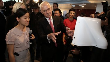 Mr Turnbull with the Teleport robot developed by Marita Cheng at Engineers Australia in Melbourne on Monday.