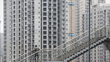 Growth in residential buildings under construction in China continues, but policymakers think that will ease.
