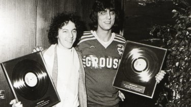 Jon English, right, and Mario Millo receive their gold records for the song <i>Six Ribbons</i>.