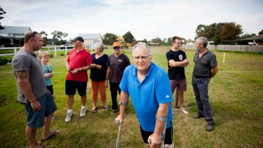 Andrew McNabb, foreground, with other Officer residents angry about new a pokies venue.