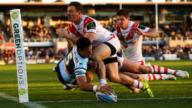 Full stretch: Valentine Holmes touches down for the Sharks.