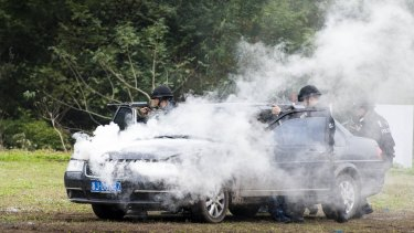 Special police attend an anti-terrorism drill in Taizhou, Zhejiang Province, China on Friday.