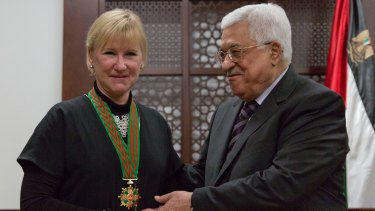 """Mahmoud Abbas decorates Swedish Foreign Minister Margot Wallstrom with the """"Grand Star of the Order of Jerusalem"""" at his office in Ramallah on December 15. Israeli officials have boycotted Ms Wallstrom's visit to the region."""