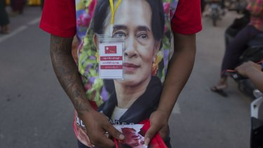 A supporter of Myanmar's opposition leader Aung San Suu Kyi's National League for Democracy party on Tuesday.