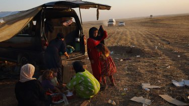 Residents of Mosul who fled their homes in June last year following Islamic State attacks.