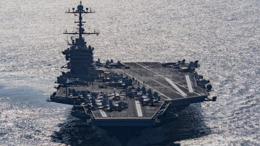 Aircraft carrier USS Harry S Truman navigates the Gulf of Oman on Christmas Day. The US Navy is being asked to tread a fine line in the world's relationship with China.