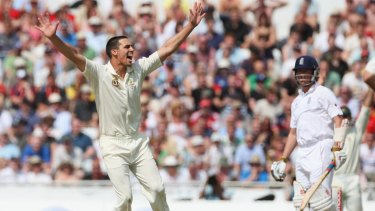 Johnson of Australia celebrates the wicket of Graeme Swann.