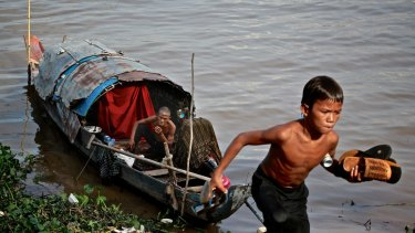 Life in Cambodia's capital, Phnom Penh, in 2013.