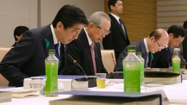 Japanese Prime Minister Shinzo Abe, left, and Takashi Imai, second left, who presented the final report on a special law for Emperor Akihito's abdication process.