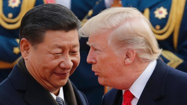 US President Donald Trump, right, chats with Chinese President Xi Jinping during a welcome ceremony at the Great Hall of the People in Beijing earlier this month.