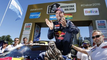 Relief: Peugeot driver Stephane Peterhansel smiles after receiving the 2016 Dakar Rally winner's trophy.