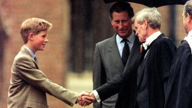 Former Geelong Grammar headmaster John Lewis, right, greets Prince Harry upon his arrival at Eton College.