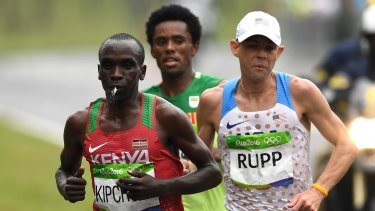 Feyisa Lilesa, centre, racing eventual winner Eliud Kipchoge of Kenya and bronze medallist Galen Rupp of the United States.