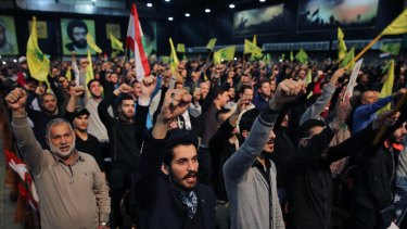 """Supporters cheer as they listen to a speech by Hezbollah leader Sayyed Hassan Nasrallah, in Beirut, Lebanon, on Tuesday. Nasrallah said Turkey and Saudi Arabia are using Islamic State as a """"pretext"""" to launch a ground operation in Syria."""
