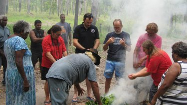 The officers (centre) took part in a traditional smoking ceremony.