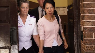 """""""We will never, ever give up"""": Kathy Lin, wife of Robert Xie, leaves the Supreme Court."""