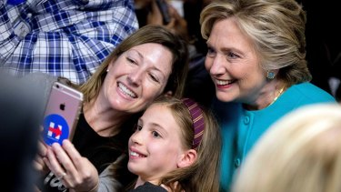 Photo op: Clinton gets a selfie with supporters in Seattle on Friday.